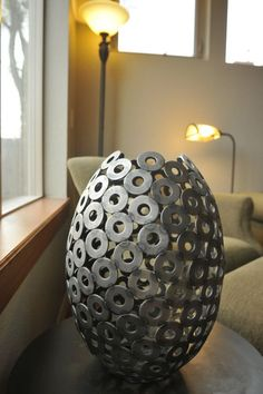 Metal sculptural vase - hand welded from from steel structural washers. Make a statement in your home with this industrial artwork!: