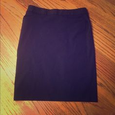 EXPRESS black mid skirt Cute button detail going down the middle of the back! Two front pencil pockets! Polyester. Form fitting and polished. Express Skirts Midi