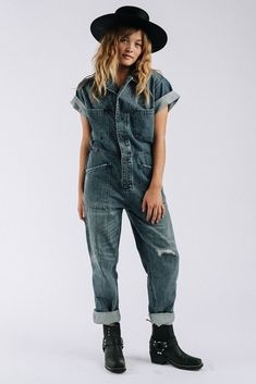 Details: Button front distressed detailed denim jumpsuit with rolled sleeves and cinched waist. Color: Denim Blue Cotton Machine wash cold, dry low Fits true to size, is oversized Model is wearing an extra small Measurements: XS: Bust = Winter Outfits, Summer Outfits, Summer Clothes, Clad And Cloth, Denim Jumpsuit, Overalls, Green Pants, How To Roll Sleeves, New Wardrobe