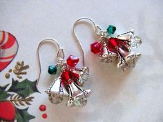 The Christmas bells earrings are made with three different sizes of antique silver pewter bell flower beads caps. Inside each bell flower is...