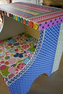 Cute step stool covered with scrapbook paper, modge podge and buttons.  Outdoor modge podge was used.  Love the buttons.