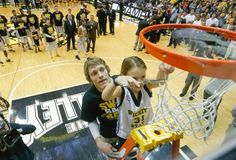 Wichita State guard Ron Baker pulled this young girl out of the crowd on Saturday to help him cut down the net after the Shockers won the Missouri Valley Conference title.