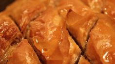 Phyllo dough is layered with a cinnamon-nut filling, then topped with a honey syrup. Serve slices in cupcake papers.
