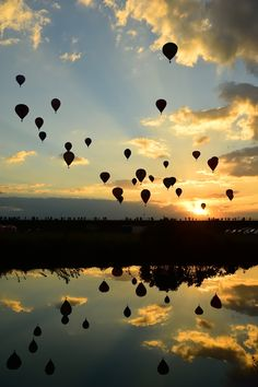 Bloons reflecting into the ocean at The Saga International Balloon Fiesta, Japan