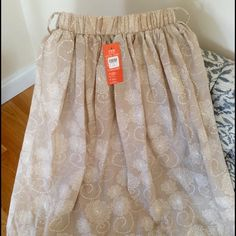 Never Worn Skirt. Falls right at or below knee. Beautiful Skirt, Bought but Never Wore. Has Placing for Cute Stylish Belt. Im 5'5 and Skirt Falls Right Below my Knee When Worn Below Bra Line. Skirts Midi