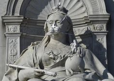 A depiction of a gas mask placed by environmental protest group Greenpeace is seen on a statue of Britain's Queen Victoria near Buckingham Palace in London, England.