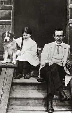 Composer and pianist Rachmaninov with his daughter and a dog.