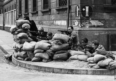 Italian Partisans defend their position in the streets of Milan. When Italy signedan armistice with the Allied armed forces and began to wage war on Germanyin 1943, German forces occupied most of Northern Italy until 1945. As a result, antifascist resistance groups formed and started guerilla warfare againstGermany and the Italian Social Republic's troops.As the war came to an end, members of the resistance seized control of the city and executed fascist leader Benito Mussolini alo...