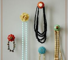 Vintage buttons on screws to make fun and fab hangers for jewelry, hats, purses, more