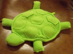 Make a simple stuffed animal out of fleece and fill it with rice, so you can war. Make a simple stuffed animal out of fleece and fill it with rice, so you can warm it up to soothe t Sewing Stuffed Animals, Stuffed Animal Patterns, Fleece Projects, Sewing Projects, Sewing Ideas, Diy Dog Blankets, Heat Bag, Hot Cold Packs, Rice Bags