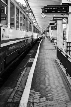 This is in the La Spezia train station, about the board the train to Milan. It was a busy trip full of lots of trains, but this one rare morning the station was near empty.  - Laura Peppe by APIstudyabroad, via Flickr