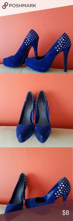 Royal blue suede high heels Very pretty color, just pops on the leg and the studs on the heel give it a little oomph.  Some tear and wear, but nothing that a suede cleaner cant fix, hence the great price! Shoes Heels