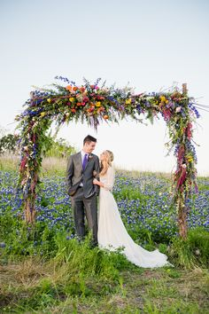 Spring Wildflower Arch Wedding Backdrop at Villa St. Clair wedding venue in Austin, Texas.