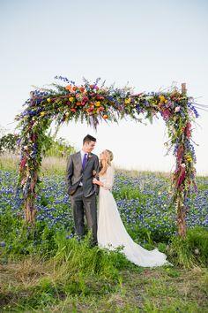 Spring Wildflower Arch Wedding Backdrop at Villa St. Clair wedding venue in Austin, Texas.