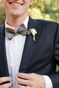 patterned bow tie with white boutonniere #buttonhole #boutonniere #bowtie #groom