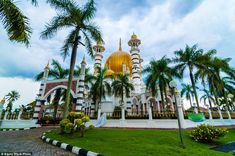 With golden domes surrounded by lush green trees, The Ubudiah Mosque  in Kuala Kangsar is ...