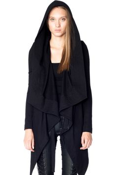 The Royal Hoodie boasts a classic SKINGRAFT silhouette, with a dramatic oversized shawl hood and draped front. — Border details around hood — Thin shoulder pads — Smooth cotton exterior — Soft stretch
