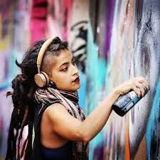 Kathrina Rupit , female street artist creating , dreadlocks rasta girl