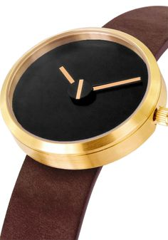 Projects Sometimes Brass Watch  The palette of Sometimes is both contemporary and classic, with elongated white hands juxtaposed against the black dial. The second hand aligns with the minute and hour for but a moment. The independent movement of the seconds appear to be out of sync with time itself.