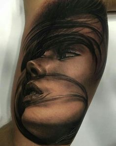 Realistic face tattoo looks mint..