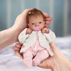 Tiny Miracles Linda Webb Celebration Of Life Emmy Realistic Baby Doll: So Truly Real by Ashton Drake by Ashton Drake. $69.99. With her RealTouch baby-soft vinyl skin, micro-rooted hair, wispy baby eyelashes and hand-painted fingernails and toenails, this realistic baby doll is a pint-sized cutie. This doll is not a toy, but a fine collectible to be enjoyed by adult collectors.. Up to 365 days on select items! If you need to make a return, you'll receive 100% of every...