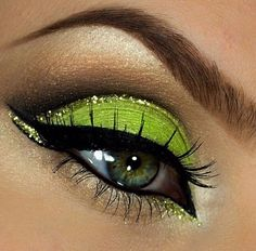 Lime green glitter eyeshadow. I love the line of glitter in the crease. Very bold, Arabic