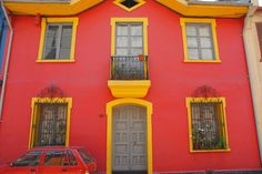 https://flic.kr/p/5HioE6 | Casa in Red and Yellow | Casa near Parque Bustamante, Providencia, Santiago, Chile. As if the house wasn't enough red for them, they had to have a red car.