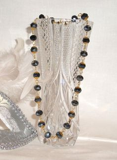 Necklace made with dark grey faceted beads with golden decorations embracing each bead. Handmade Jewelry, Made in Italy, Ready To Ship!