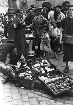 Warsaw, Poland, A woman displaying her merchandise.    Taken by the German photographer Willi George in the summer of 1941. The photographs are unique in that they were not staged, but showed the ghetto as it truly was.