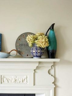 Victorian House London. Cast iron reclaimed fireplace and bedroom walls painted in Hardwick White, vintage jugs and dried hydrangea. Interior Design by Imperfectinteriors.co.uk