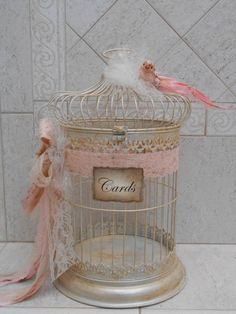 This beautiful birdcage wedding card holder would be the perfect addition to any shabby or vintage inspired wedding decor. Cage has been painted with