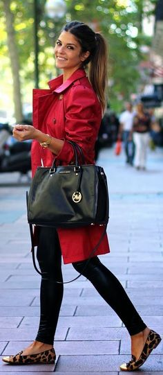 Making a great fashion statement is all about the pieces you put together. That is why I love this whole outfit. Red jacket, black tights, this beautiful back handbag and the leopard flats to complete it! This is simply lovely!