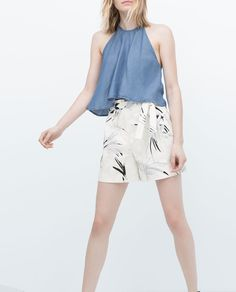 PRINTED BERMUDA SHORTS WITH PLEATS