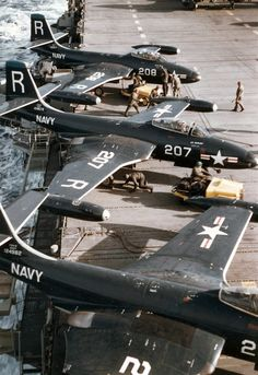 Banshee aircraft of Fighter Squadron (VF) 172 pictured being serviced by maintenance personnel are on the flight deck of the carrier Essex (CV operating off the coast of Korea, at the height of the Korean War. Military Jets, Military Aircraft, Fighter Aircraft, Fighter Jets, Navy Aircraft, Navy Marine, Military Photos, Flight Deck, Navy Ships