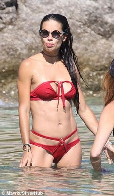 Sunning herself: Adriana wore sunglasses to protect her eyes from the reflections in the water