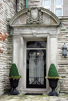 Front Entrance Stone arch glass and iron door