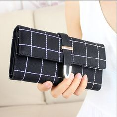Item Type:Wallet   Color:Blue,Black,Pink,Sky Blue,Rose Red   Material:PU Leather     Weight:200  g     Length: 19cm(7.48'')  Height: 9cm(3.54'') Width:3cm(1.18'')   Pattern:Geometric   Closure:  Zipper                    Package Included:   1 * Bag