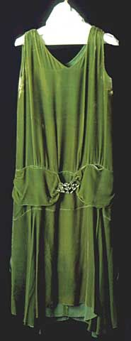 Chartreuse transparent silk velvet sleeveless chemise evening dress has V-neck, fullness gathered at shoulder seams, below waist cummerbund embellished with a faceted glass and metal buckle, and bias cut skirt with uneven hem. Bias drape appears at back.