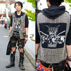 Yuhei is a punk-loving guy who we met in Harajuku. His outfit features handmade crust punk patch pants with a studded vest, a hoodie from Disk Union Rockweb and boots. -TokyoFashon