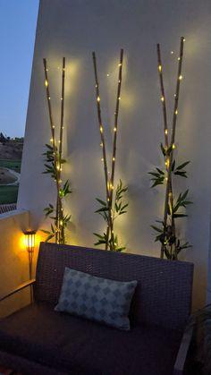 Solar Fairy Lights, Outdoor Fairy Lights, Small Balcony Design, Small Balcony Decor, Bamboo Sticks Decor, Background Winter, Bamboo Light, Balcony Lighting, Porch Decorating