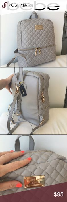 BEBE Paloma Grey & Gold Danielle Backpack! Brand New but no tag. 100% authentic Back pack is perfect  MSRP $119.00  With gold hardware  Bebe logo on the front • Large backpack could fits a lot of things inside great for school or traveling.(FITS MacBook Air 13').  •Dimension: L12.5in X H14in X W5.2in Handle length 10.2in Straps are remove able and adjustable  • front pocket • Removable shoulder straps/adjustable straps  • Inside: 2 pockets & 1 zipper pocket  • And one back pocket that you…