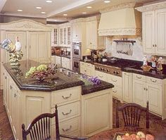 Countertops that go well with victorian cabinets white for Buttercream kitchen cabinets