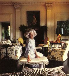 """Nancy """"Princess"""" Pyne at her estate Cherryfields. Club chairs upholstered in a fabric later interpreted by Schumacher and named """"Pyne Hollyhock."""""""