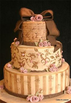Imagine this cake without the frou-frou icing roses and the oh-so-sweet ribbon draped across the top.  THAT would be gorgeous.