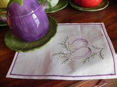 machine embroidered aubergine from a sauce boat
