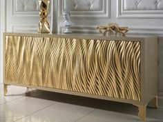 Add a touch of style with the Gold leaf wave fronted buffet sideboard in a high gloss cappuccino lacquered structural finish with stainless steel gold baroque legs.