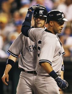 GAME 26: Friday, May 4, 2012 - New York Yankees' Derek Jeter (2) and Chris Stewart (19) celebrate Jeter's two-run home run during the seventh inning of a baseball game against the Kansas City Royals in Kansas City, Mo. (AP Photo/Orlin Wagner)
