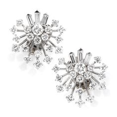 A Pair of Diamond and Platinum Ear Clips, by Van Cleef & Arpels, circa 1950 #snow queen