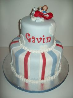 This cake was designed around a figurine of a little boy flying in a vintage red airplane.  A little smash cake was made for Gavin to match cake.  His name was made to look like his plane had written it in sky writing.