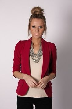 I like the red cropped jacket with cream colored top. The statement necklace is pretty too.